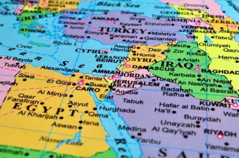 A multicolored map of the Middle East. With U.S. disengagement come new questions and risks, say Tufts alumnae foreign relations experts at IGL forum.