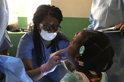 a doctor looking into a child's mouth