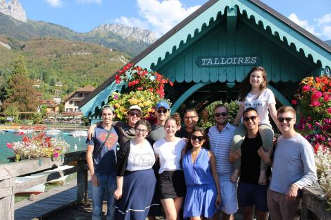 students standing in front of a covered bridge in Talloires
