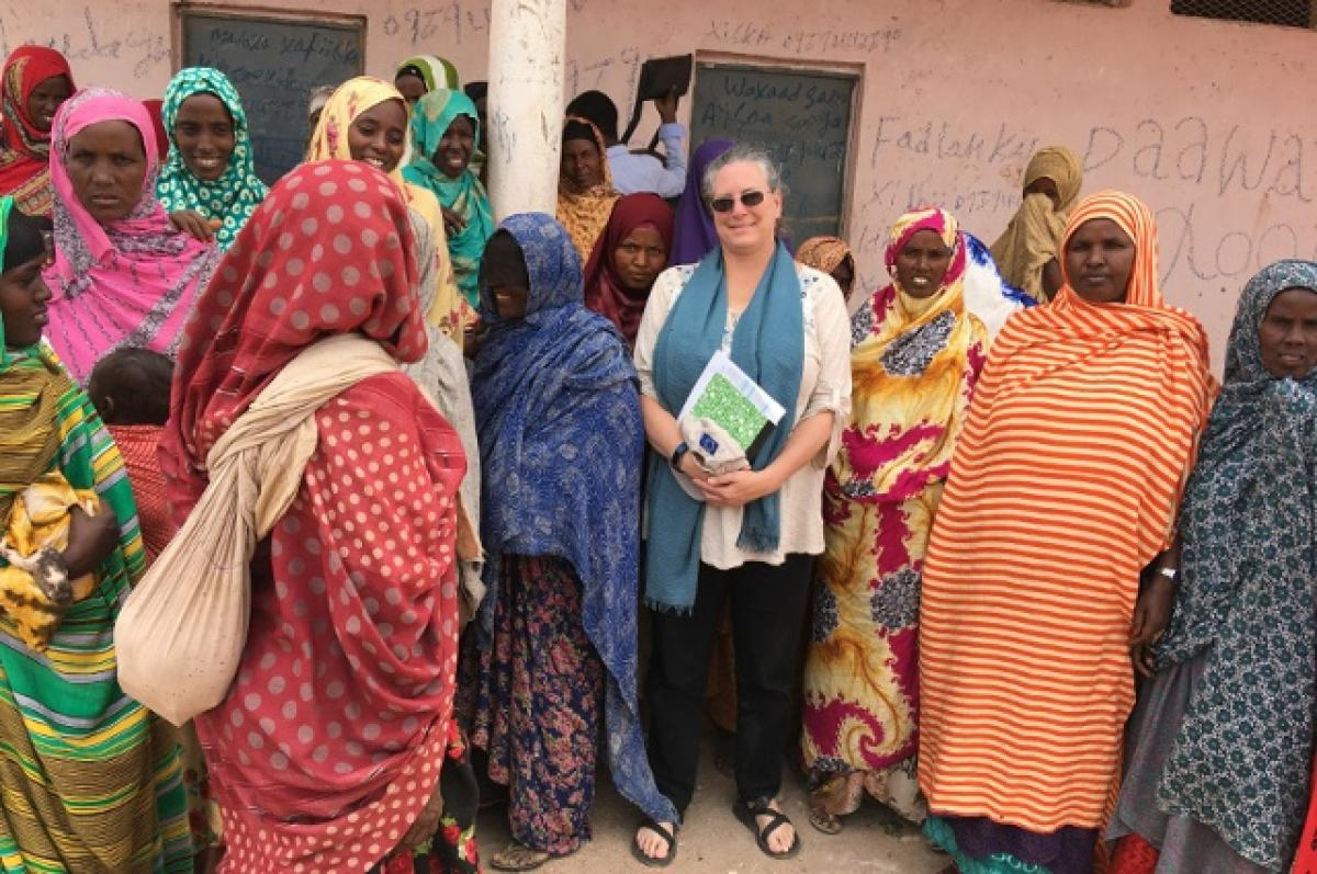 Christine Jost with a number of Somali women. A Cummings School and Fletcher School alum, Jost works to get U.S. aid where it's needed to fight COVID-19, locusts, and other emergencies across the globe